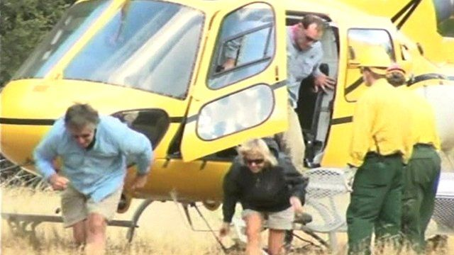 People leaving rescue helicopter