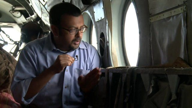 Sanjoy Majumder on board an Indian helicopter flying aid to Kashmir flood areas