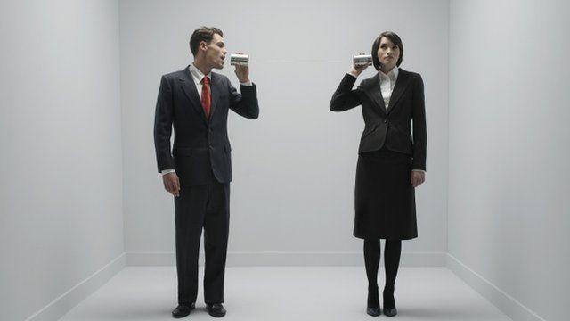 Man talking to woman through tin can