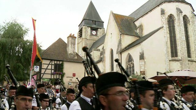 Bagpipe parade through French town