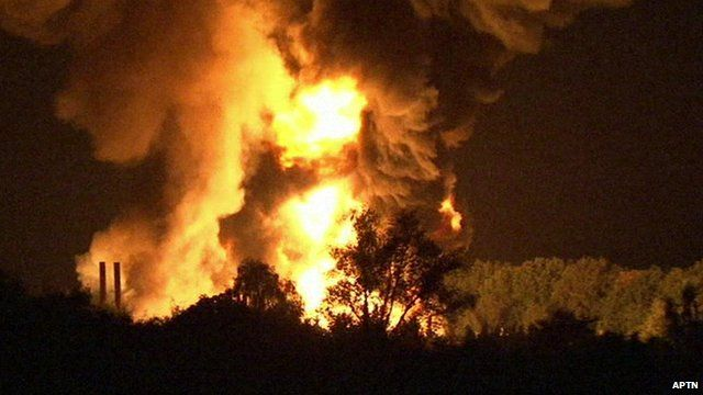 Flames and smoke rising into the night sky after blast at chemical factory in Bremen, Germany