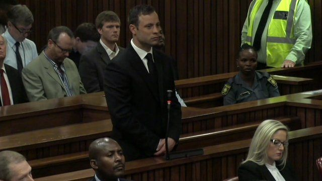 Pistorius stands in court