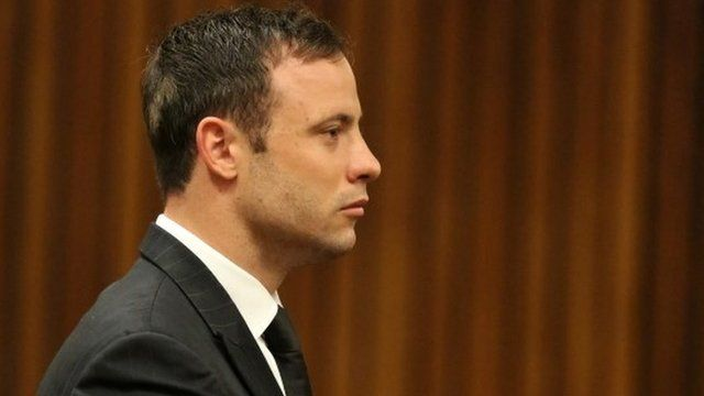 Oscar Pistorius stands in the dock looking straight ahead in court in Pretoria, South Africa, Friday, Sept. 12, 2014