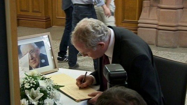Martin McGuinness signs book of condolence for Mr Paisley at the Guildhall in Londonderry