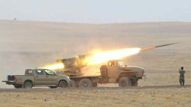 Kurdish forces launching rocket from vehicle