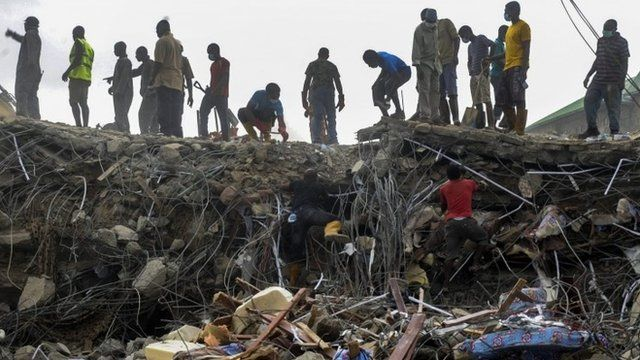 Nigerian rescue workers searching through rubble from the collapsed guesthouse at the Synagogue Church of All Nations in Lagos