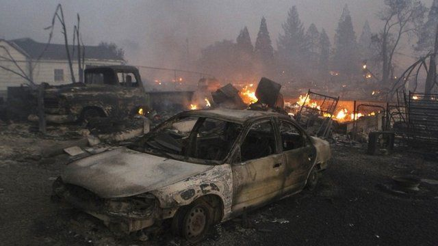 Vehicles and homes are destroyed in Weed, California where a wind-driven wildfire raced through the hillside neighbourhood
