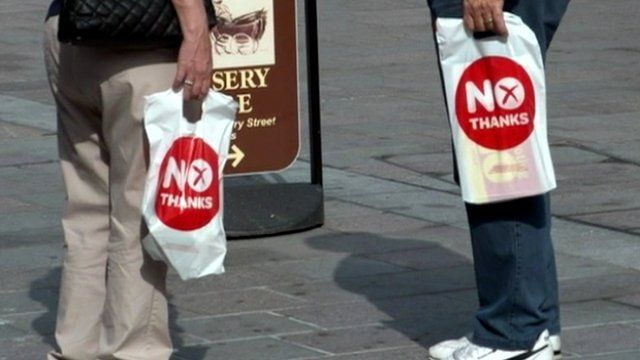 People carrying 'No thanks' bags