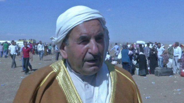 Kurdish refugee on border between Syria and Iraq