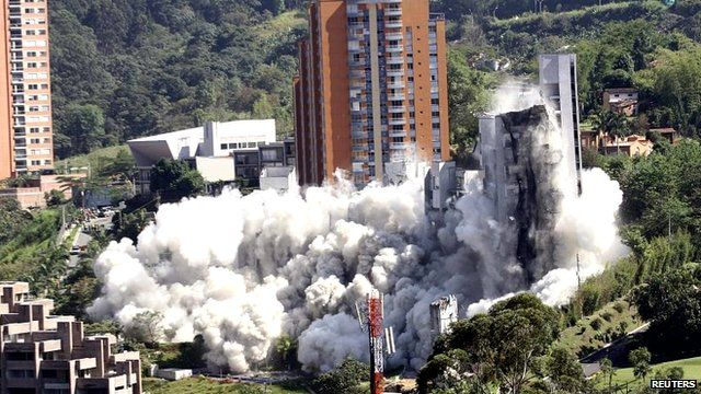 The flats are demolished during a controlled demolition in Medellin