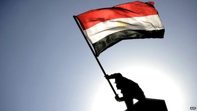 Man waving Egyptian flag