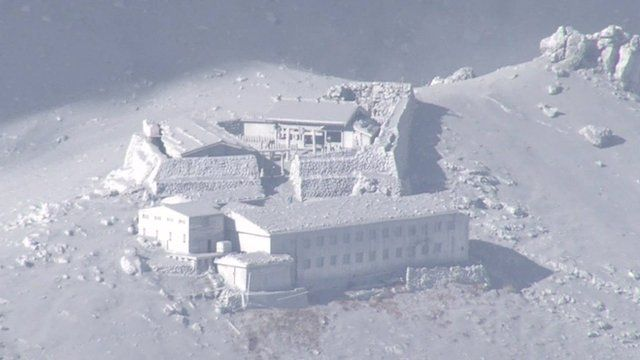 Buildings near Mount Ontake are covered in volcanic ash