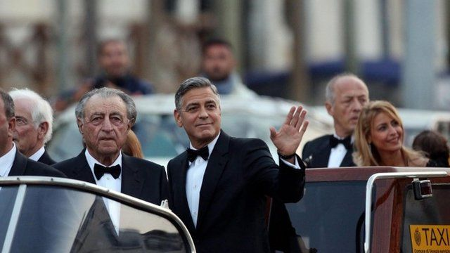 George Clooney on the Canal Grande on the way to his wedding with Amal Alamuddin, in Venice