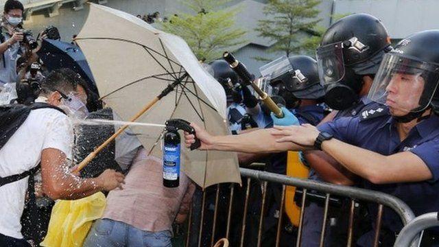 Riot policeman spraying pepper spray