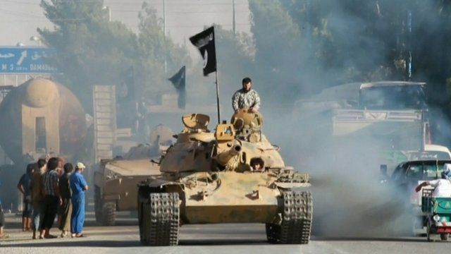 An Islamic State fighter on a tank
