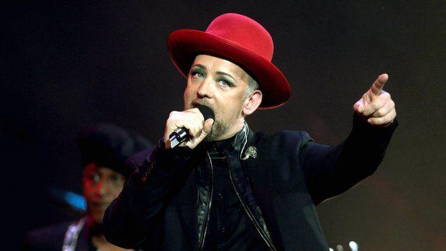 Boy George performing on stage