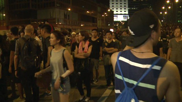 Protesters milling about after dark