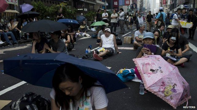 Protesters with umbrellas at at Mongkok shopping district