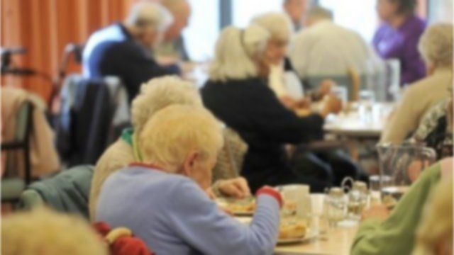 Elderly people eating