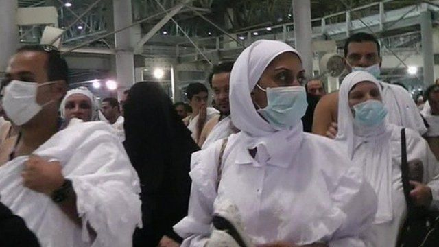 Crowds at the Hajj - some wearing face masks