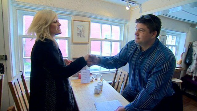 Employment advisor shakes hands with sufferer of anxiety