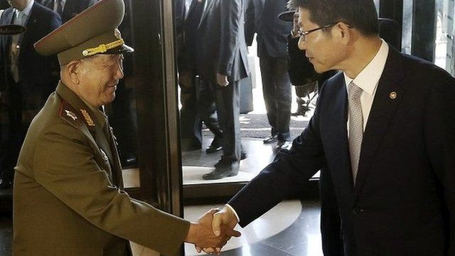 Hwang Pyong-so, left, is greeted by South Korean minister Ryoo Kihl-jae in Incheon, South Korea - 4 October 2014