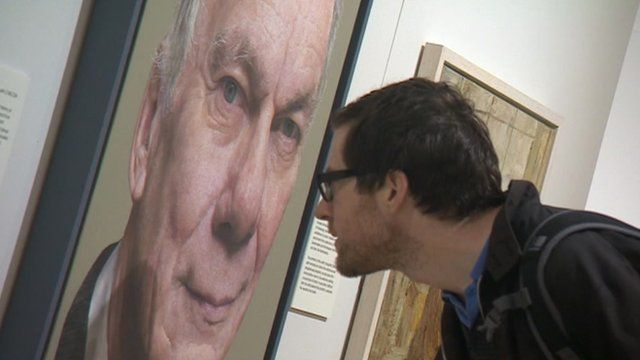 Man looking at portrait