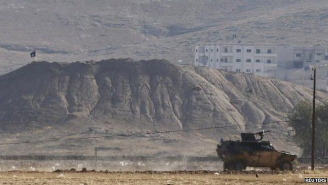 IS flag on hill over Kobane, 6 Oct