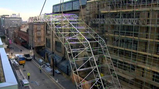Temporary roof is hoisted into place at Glasgow School of Art