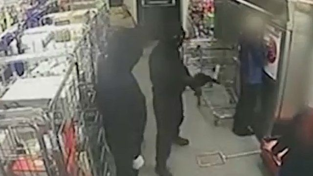 Robber points gun at shop worker
