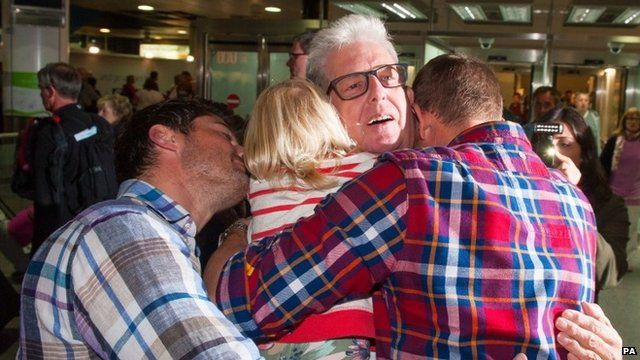 Ray Cole hugging his family