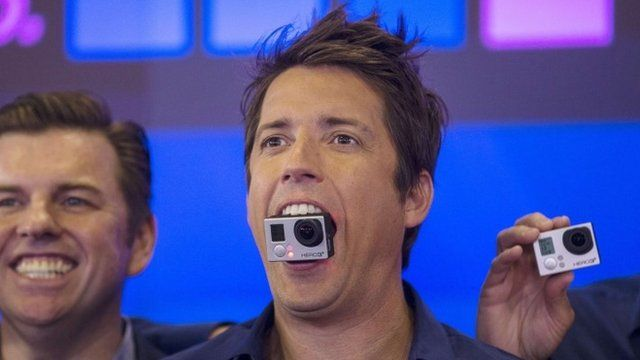 GoPro Inc's founder and chief executive Nick Woodman holds a GoPro camera at the Nasdaq Market