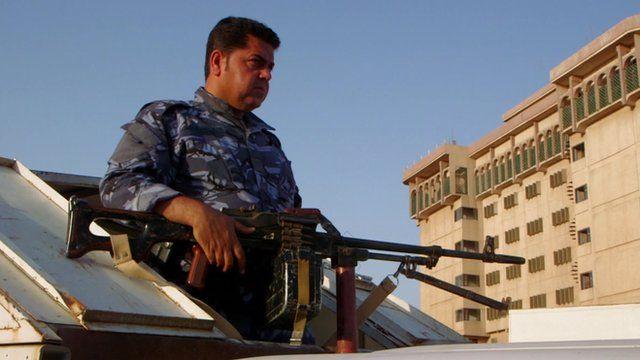 Member of Peshmerger unit carrying gun