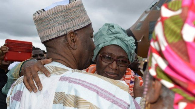 Cameroon's Deputy Prime Minister Amadou Ali (L) greets his wife Akaoua Babiana