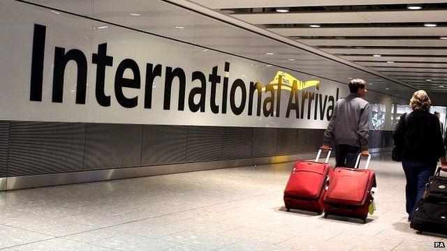 Passengers arrive at Heathrow Airport, London