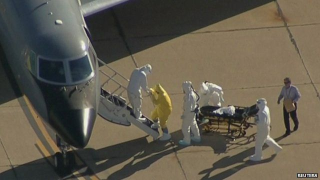 Ebola patient Amber Vinson is helped onto plane before flight to Atlanta for treatment