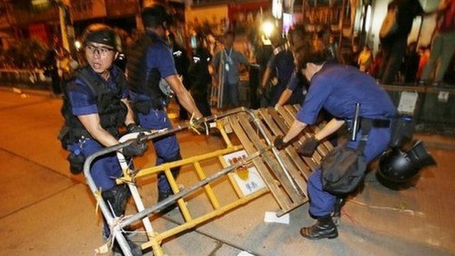 Riot police remove barricades at the pro-democracy camp in Mong Kok - 17 October 2014