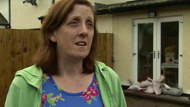 Mary Young says the fire brigade had to pump water away from her house after it was flooded