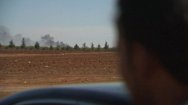 A plume of smoke in the distance