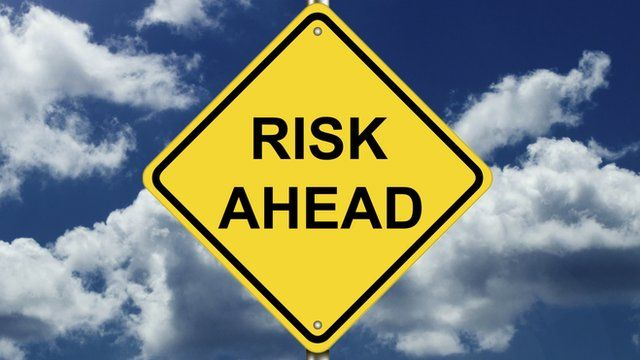 """Road sign saying """"risk ahead"""""""