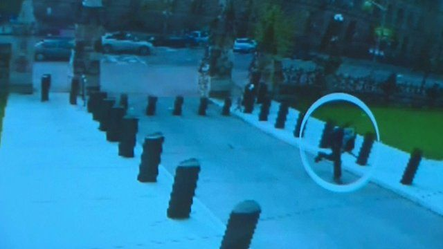 The suspect running towards the parliament building