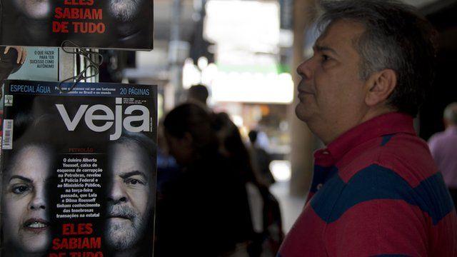 Man looking at Brazil Electoral poster