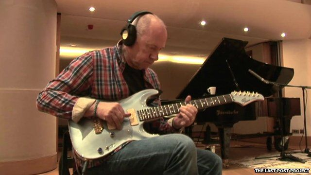 Mark Knopfler with guitar