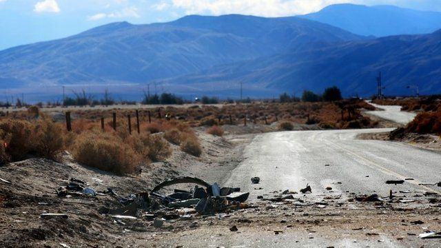 Debris from SpaceShipTwo lies on the desert field and road on November 1, 2014, in Mojave, California