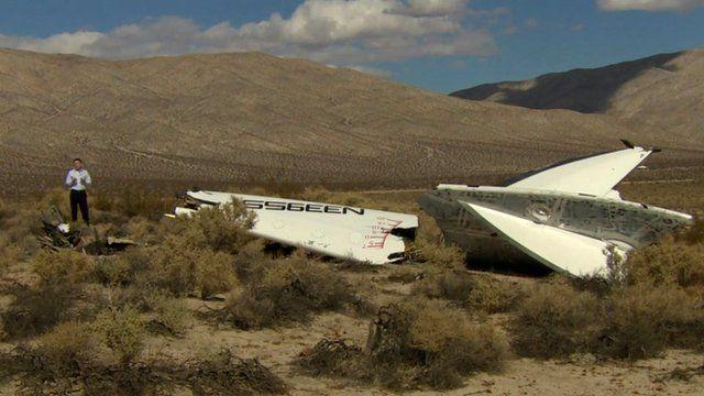 David Willis stands beside wreckage of Virgin Galactic SpaceShipTwo in Mojave desert