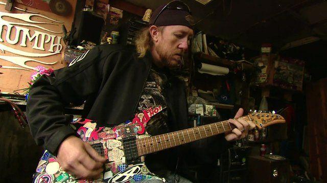 Man playing guitar in Kentucky