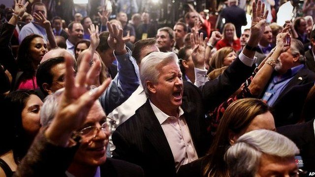 """Daryl Johnson, centre, screams, """"Four more years,"""" for Gov. Rick Scott along with the crowd of supporters as they watch the election results at the Hyatt Regency Coconut Point in Bonita Springs"""