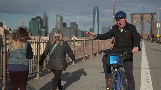 John Maguire on a bike on Brooklyn Bridge