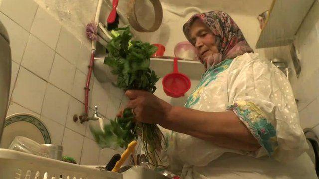Fatima washing mint leaves