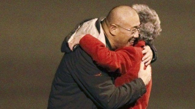 Kenneth Bae and his mother Myung Hee Bae embrace as they reunite at Joint Base Lewis-McChord, Washington